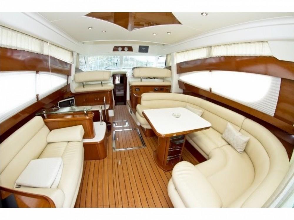Rental Motor boat in Cannigione - Jeanneau Prestige 46 Fly-a