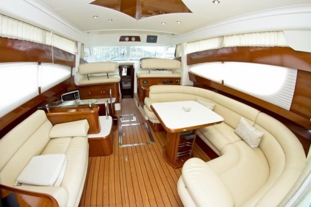 Rent a Jeanneau Prestige 46 Fly-a Cannigione